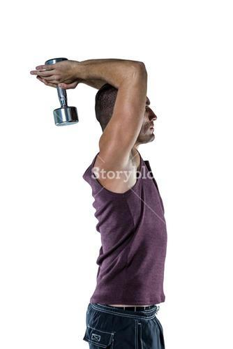 Profile view of athlete working out with dumbbells