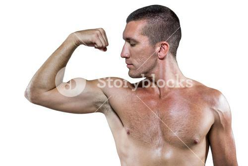 Confident shirtless athlete flexing muscles