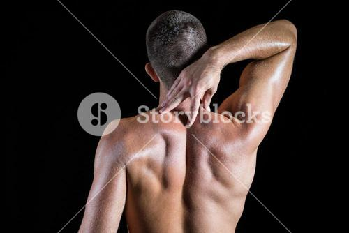 Shirtless man with neck pain