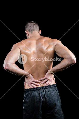 Shirtless man touching back