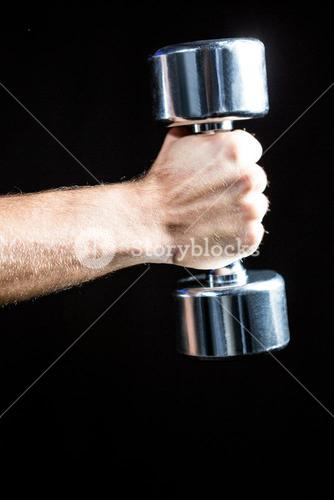 Close-up of of man working out with dumbbell
