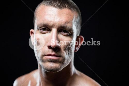 Serious shirtless sportsman standing