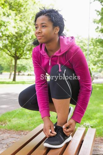 Hipster tying her shoelace