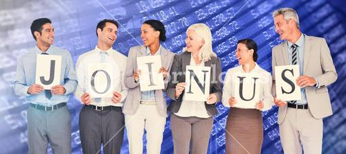 Composite image of business people holding letters sign
