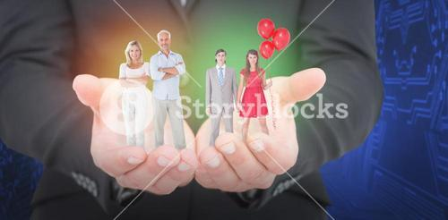 Composite image of unsmiling geeky couple standing hand in hand