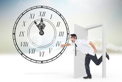 Composite image of geeky young businessman running late
