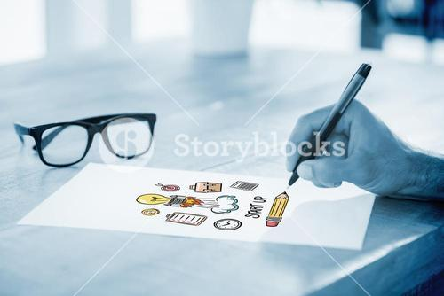 Composite image of side view of hand writing on white page on working desk