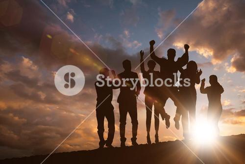 Composite image of silhouetters celebrating