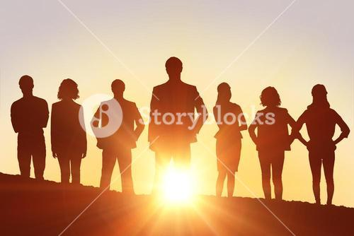 Composite image of silhouettes standing
