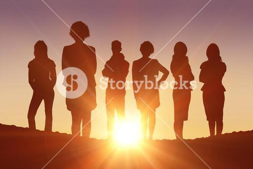 Composite image of standing silhouettes