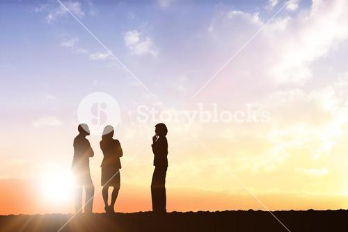 Composite image of business colleagues talking