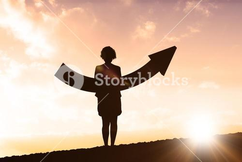 Composite image of businesswoman with arrow