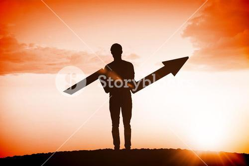Composite image of businessman with arrow