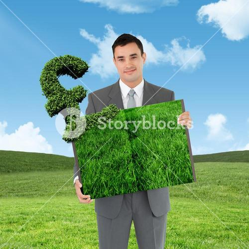 Composite image of man holding lawn book