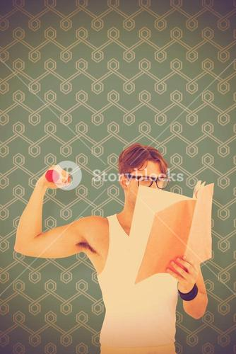Composite image of geeky hipster lifting dumbbells and reading notepad