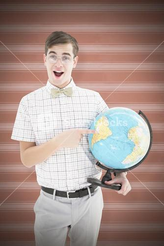 Composite image of geeky hipster holding a globe smiling at camera