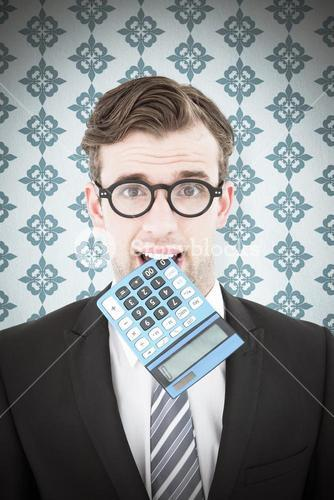 Composite image of geeky businessman biting calculator