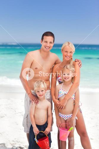 Radiant family on the beach