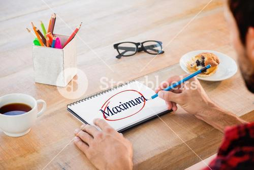 Maximum against creative businessman writing notes on notebook