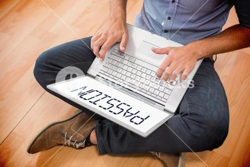 Passion  against young creative businessman working on laptop