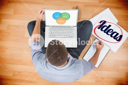 Ideas  against young creative businessman working on laptop