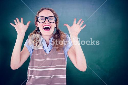 Composite image of geeky hipster woman smiling and showing her hands