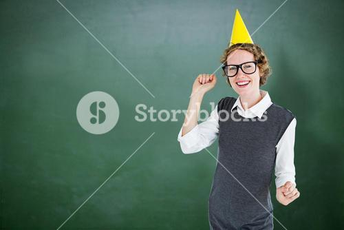Composite image of geeky hipster wearing a party hat