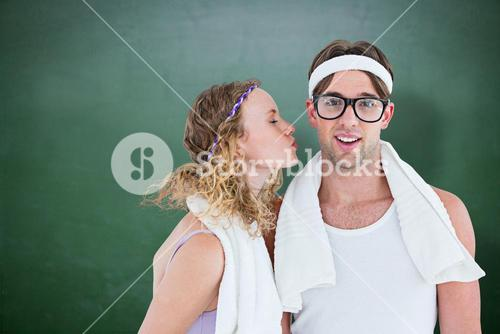 Composite image of geeky hipster kissing her boyfriend