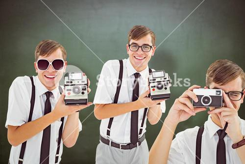 Composite image of geek with camera
