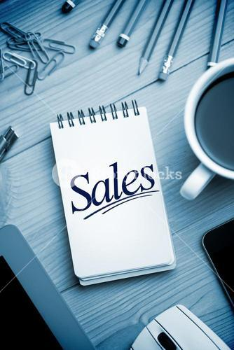 Sales against notepad on desk