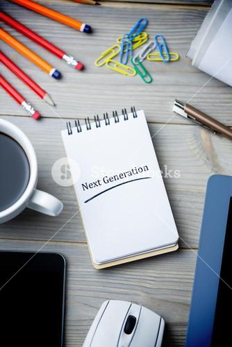 Next generation against notepad on desk
