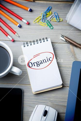 Organic against notepad on desk
