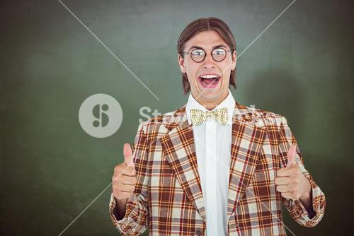 Composite image of smiling geeky hipster smiling at camera
