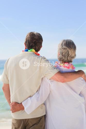 Enamored couple looking at the sea