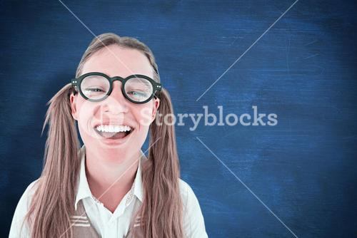 Composite image of female geeky hipster smiling at camera