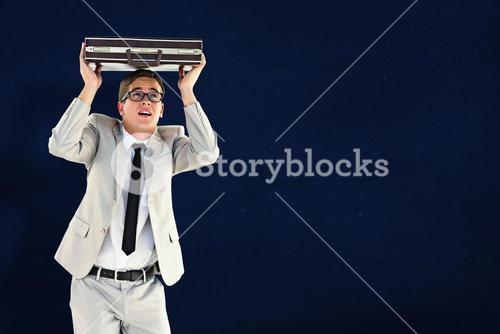 Composite image of handsome businessman sheltering with briefcase