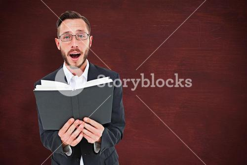 Composite image of young preacher reading from bible