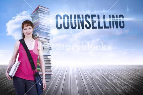 Counselling against stack of books against sky