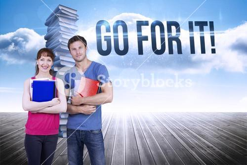 Go for it! against stack of books against sky