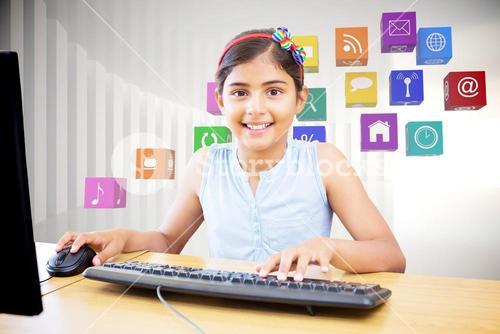 Composite image of school kid on computer