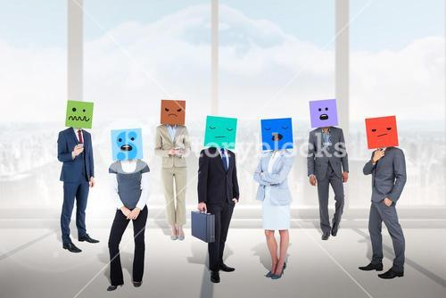 Composite image of people with boxes on their heads
