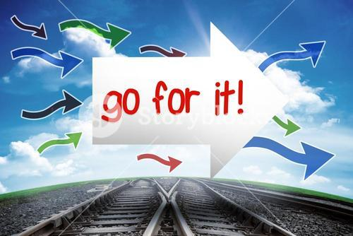 Go for it! against railway leading to blue sky