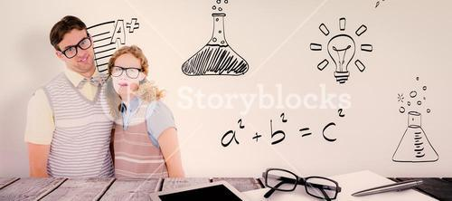 Composite image of happy geeky hipster couple with silly faces