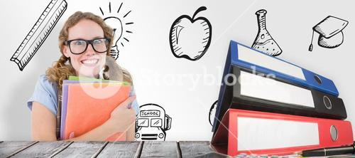 Composite image of geeky hipster woman holding files