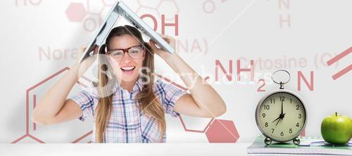 Composite image of geeky hipster holding her laptop over her head