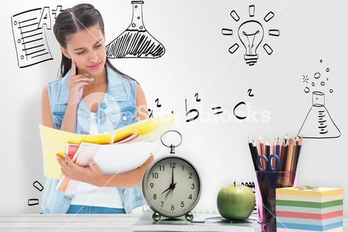 Composite image of student studying from folders