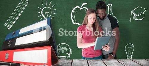 Composite image of creative team looking at digital tablet