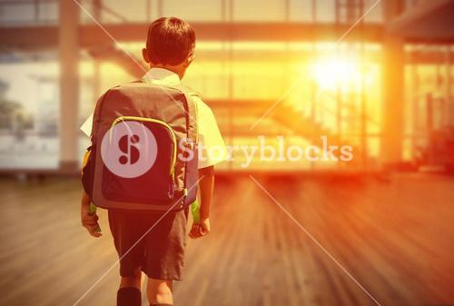 Composite image of cute pupil walking to the school bus