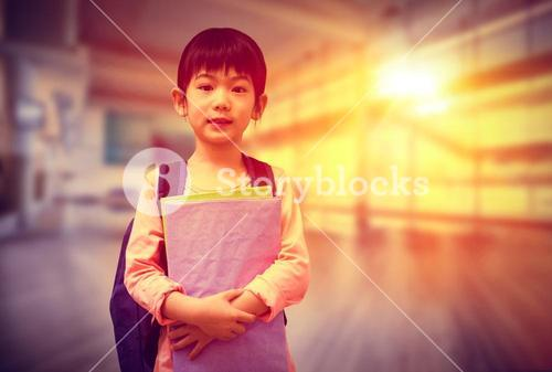 Composite image of cute pupil looking at camera holding notepad