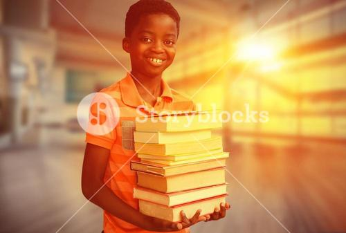 Composite image of portrait of cute boy carrying books in library